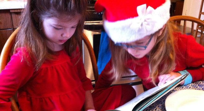 Lucy and Rosie reading.